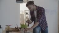 4K: Carpenter Eating Sandwich At Work. video