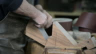 Carpenter in a workshop video