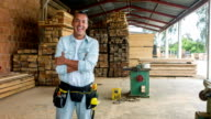 Carpenter looking happy at his carpentry video