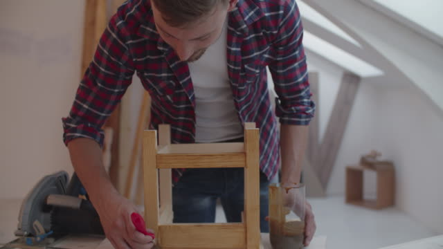 4K: Carpenter painting furniture video