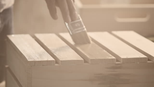 Carpenter painting wooden furniture video