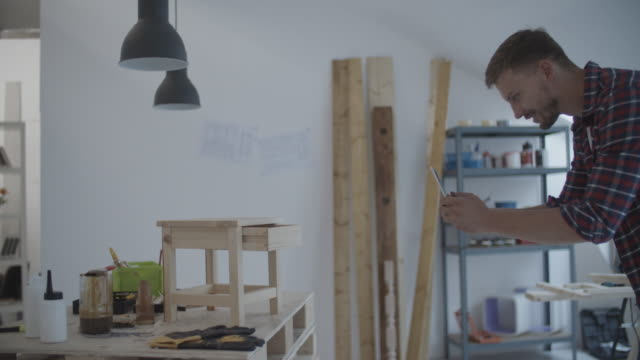 4K: Carpenter Photographing Furniture With Digital Tablet. video