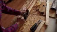 carpenter planed wood, workplace video