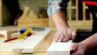 Carpenter sanding wood video