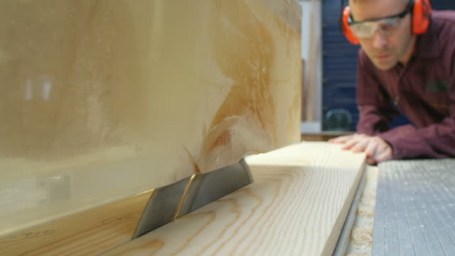 Carpenter Using Circular Saw In Carpentry Workshop video