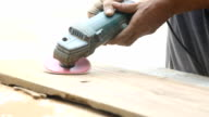 carpenter using sander on wood video