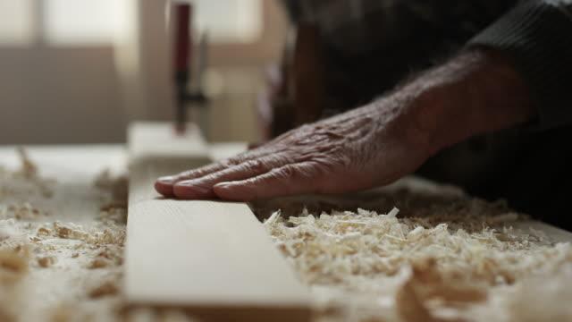 Carpenter working in his workshop video