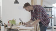 4K: Carpenter Working On New Project In His Workshop. video