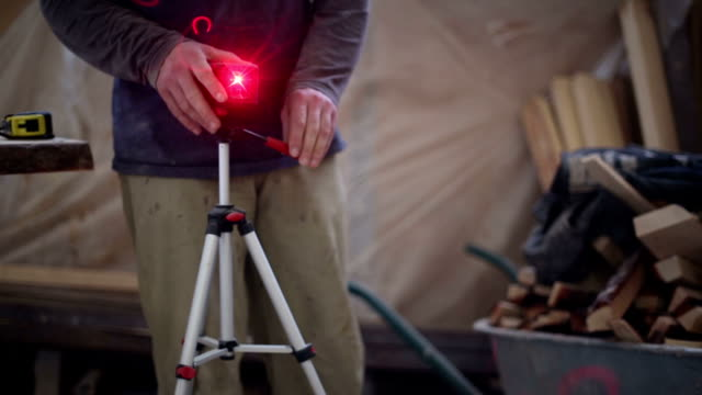 Carpenter working with a construction laser level video