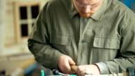 Carpenter working with machine in workshop video
