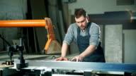 Carpenter working with sandpaper video