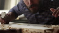 Carpenter working with sandpaper video