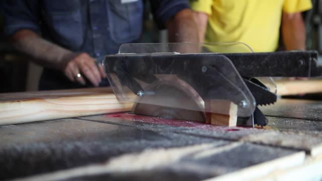 Carpenters hard at work cutting wood video