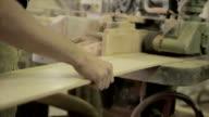 Carpenters in workshop on a machine video