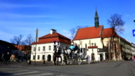 Carriage of horses passes City Hall Square in Krakow video