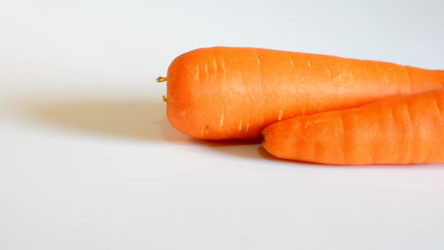Carrot on white background video