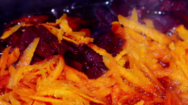 carrots and beets are simmered in a frying pan video