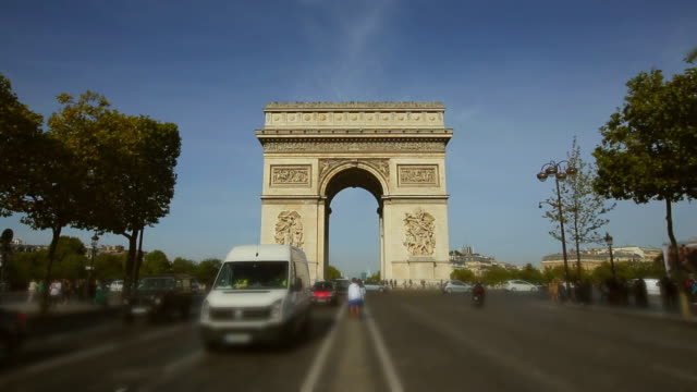 Cars and buses drive on Champs Elysees with Arc de Triomphe. Paris, France video