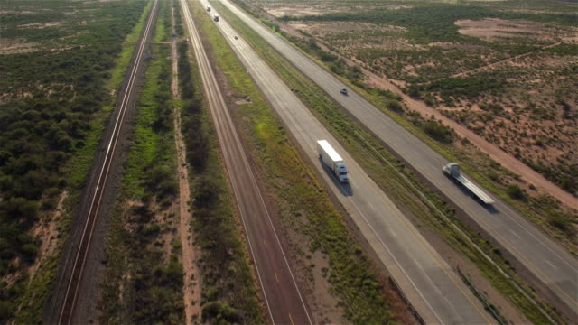 AERIAL: Cars and transportation semi trucks driving on busy highway video