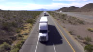 Cars and trucks driving on busy highway, freight semi trucks transporting goods video