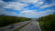 Cars and trucks speeding on busy motorway video