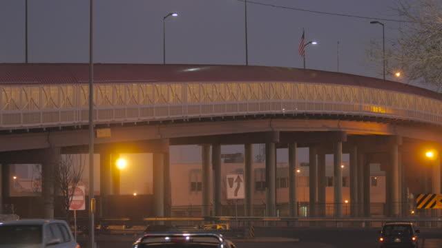 Cars and Trucks Under the Border Crossing Bridge video
