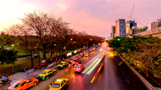 Cars, buses, taxis and people crowd on street at Jatujak park, Bangkok Thailand video