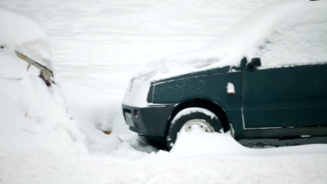 Cars covered with snow completely video