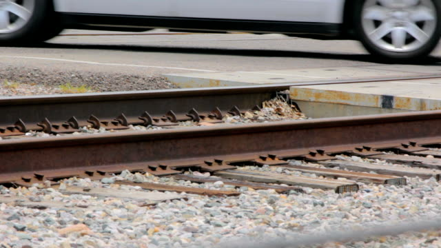 Cars Cross Railroad Tracks at RR Crossing video