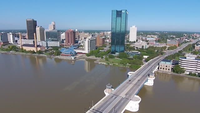 Cars crossing bridge in front of Toledo, Ohio Skyline Aerial video