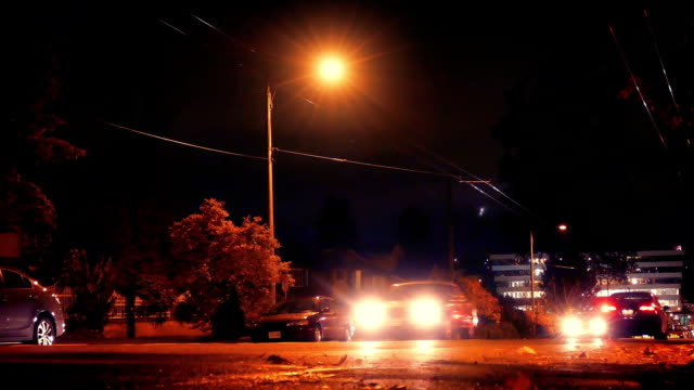 Cars Drive Past On City Road At Night video