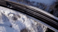 AERIAL: Cars driving along the road in winter video