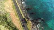 AERIAL: Cars driving on amazing picturesque coastal road above the ocean cliffs video
