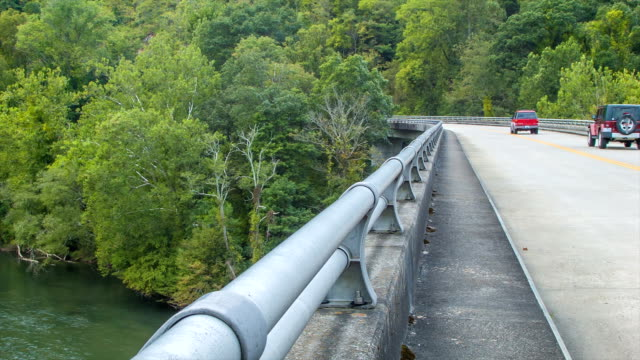 Cars Driving on Bridge Over French Broad River in Asheville video