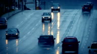 Cars Driving On Wet Road In Rain Shower video