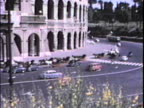 Cars go by the Colosseum-From 1960's film video