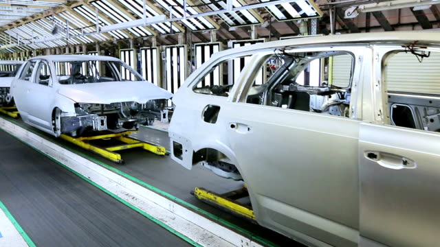 cars in a row at car plant video