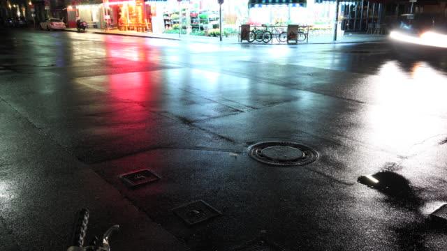 Cars in the Berlin's night on a wet street 4K video