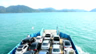 cars loaded on a ferry and headed for the island , Koh Chang , Trat, Thailand. video