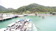 Cars loaded on a ferry and headed to Koh Chang Island at Trat, Thailand video
