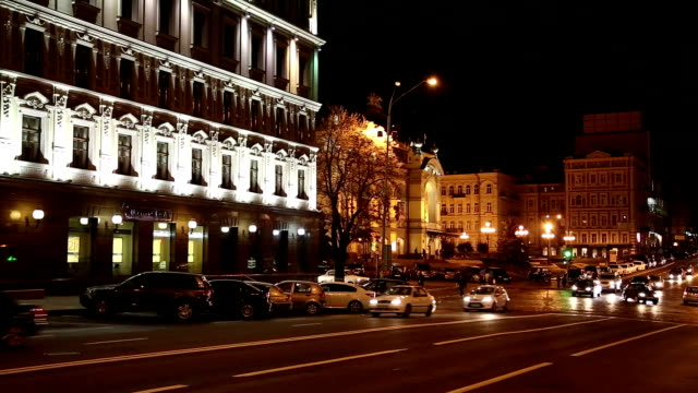 Cars near building with night illumination video