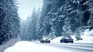 Cars On Winter Highway In Blizzard video