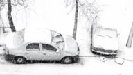 Cars parked on the roadside in winter time. video