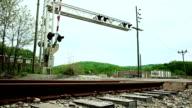 Cars passing railroad crossing video
