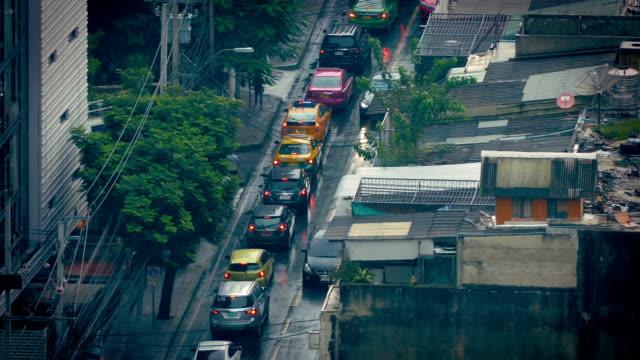 Cars Passing Slums On Rainy Day video