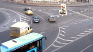 Cars stopping at a traffic light. Timelapse. Rapid movement of cars on city streets. In evening time. video