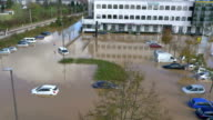 AERIAL: Cars stuck in flooded parking video