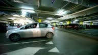 Cars turning on crossing in underground car park video