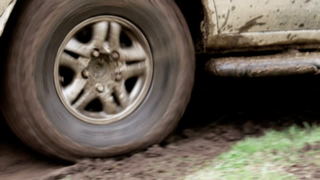 Car's wheels in mud in the forest, off-road. video