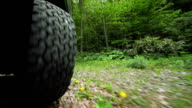 Car's wheels in  the forest video